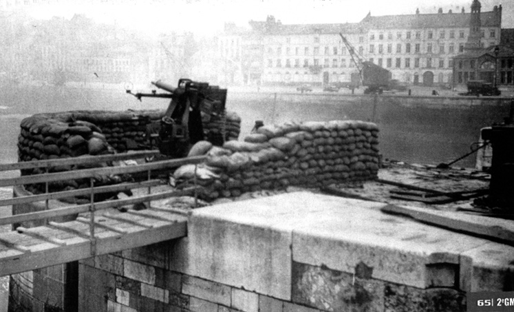 The sandbagged defensive position at the north end of the Gare Maretime