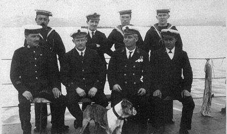 The Petty Officers and ship's mascot on M18
