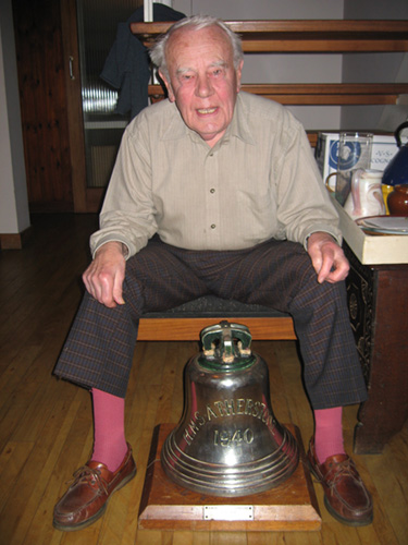 Stephen Barney and the bell of HMS Athelsone